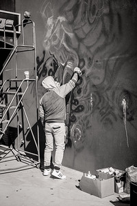 Melaine Moore works on The Devil's Triangle Temptress Mural.
