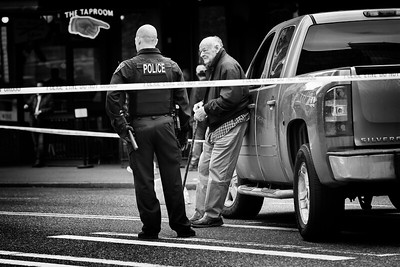 An 86-year old man rests against his truck after hitting and seriously injuring a woman in the crosswalk at 1st Ave and Pine in downtown Seattle. The man was taken into custody for investigation of vehicular assault. Still now wonder on how the woman is doing was on a honeymoon with her husband.