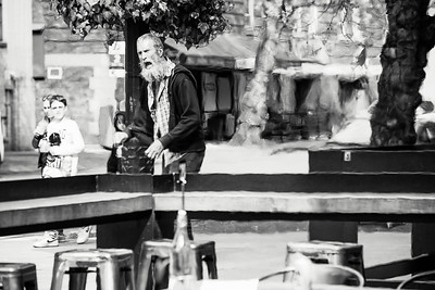 The bearded man is yelling and screaming about something after begging for food money and being turned down. The painterly apperance is the result of shooting through heat waves from an outdoor restaurant's gas heater on King Street near the train depot.