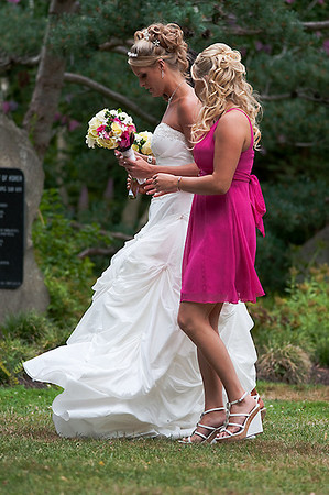 Bride and bridesmaid at Van Dusen Gardens