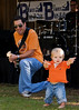 Albert Castiglia performs with one-year-old Jonas Walters, Jr.