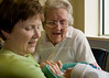 Grandmother Linda and Great Grandmother Olive inspect newborn Owen Fryman.