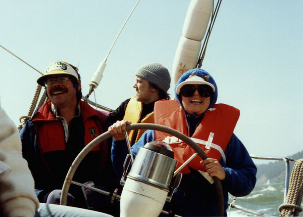 Kay at the helm of the Gold Dust on San Francisco Bay. Scanned slide, ca. 1980,
