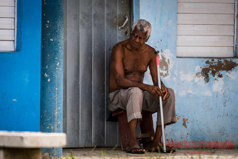 Cuban man watches the world go by