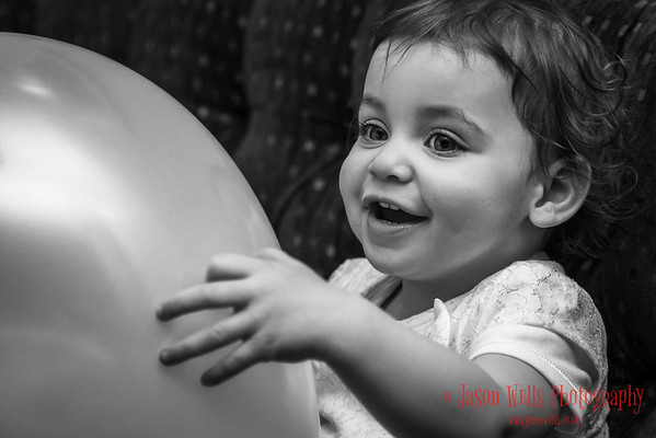 Bella playing with a balloon.