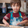 Rolling the Dough - A boy helps his mother in their kitchen.