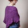 The Purple Shawl - Woman showing off a shawl that she had knitted.