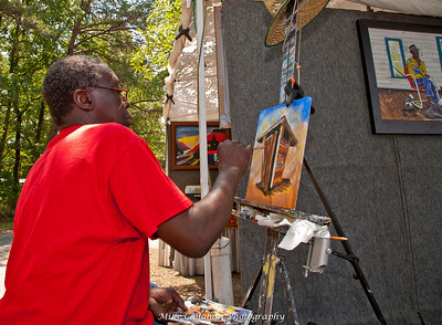 Mr. Maurice Cook, who is master with oils and canvas.