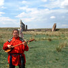 Playing a type of lute known as a khomys. (Khakassia, Russia)