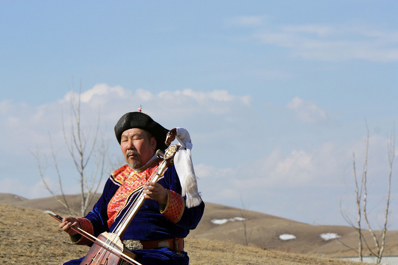 "Buryat throat singer, Leonid Babalaev, playing a morin khuur on the steppe near Aginskoye. (Zabaikal Krai, Siberia)<br /> <br /> You can read more on the music of Siberian Buryats & Mr. Babalaev here. <a href=""http://www.worldandi.com/subscribers/feature_detail.asp?num=27086"">http://www.worldandi.com/subscribers/feature_detail.asp?num=27086</a>"