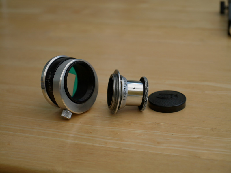 This is a Periflex focus adapter, it takes a Leica threaded lens and was intended to be a cheap way of focusing with extension tubes or bellows.<br /> <br /> The concentric mount was to let the thing rotate (fixed by the thumb screw) and in the next picture you'll see the flat for the tripod.
