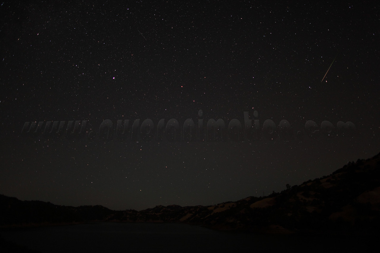 A rainbow colored Perseid meteor captured at 3:45 am (PDT) on August 12, 2012. The scenery is lightly illuminated by a waning crescent Moon. <br /> <br /> Location: Lake Berryessa, Northern California<br /> Camera: Canon EOS 5D Mark II - Lens: Canon EF 24mm f/1.4 L