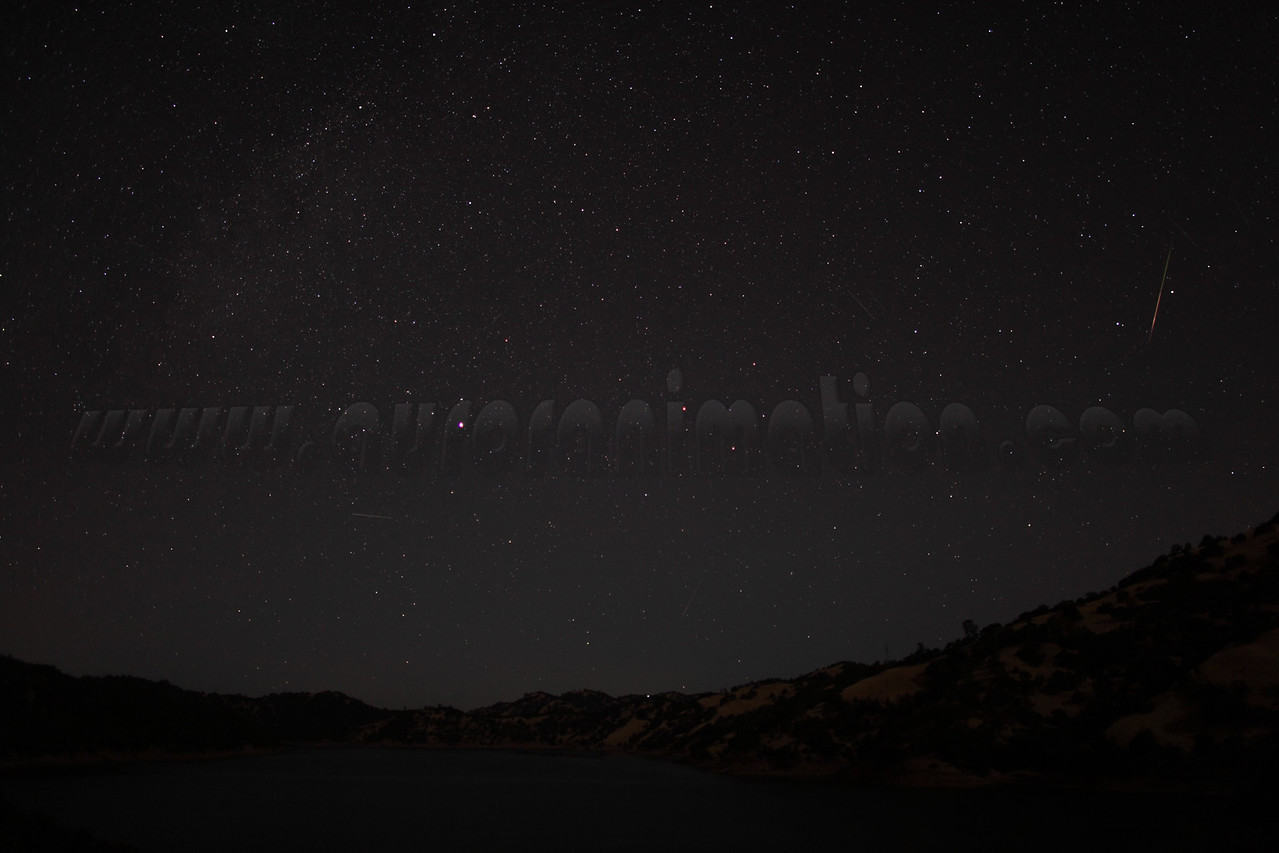 A rainbow colored Perseid meteor captured at 4:43 am (PDT) on August 12, 2012. The scenery is lightly illuminated by a waning crescent Moon.  <br /> <br /> Location: Lake Berryessa, Northern California<br /> Camera: Canon EOS 5D Mark II - Lens: Canon EF 24mm f/1.4 L