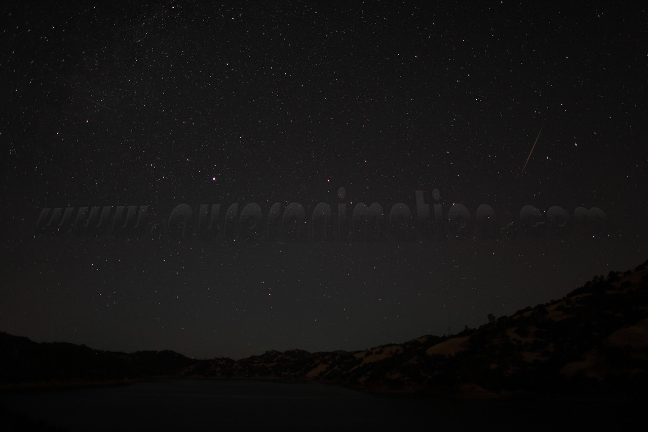 A rainbow colored Perseid captured at 4:16 am (PDT) on August 12, 2012. The scenery is lightly illuminated by a waning crescent Moon.  <br /> <br /> Location: Lake Berryessa, Northern California<br /> Camera: Canon EOS 5D Mark II - Lens: Canon EF 24mm f/1.4 L