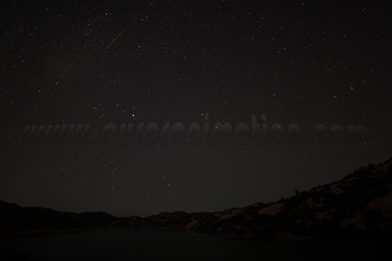 A rainbow colored Perseid meteor captured at 4:25 am (PDT) on August 12, 2012. The scenery is lightly illuminated by a waning crescent Moon.  <br /> <br /> Location: Lake Berryessa, Northern California<br /> Camera: Canon EOS 5D Mark II - Lens: Canon EF 24mm f/1.4 L