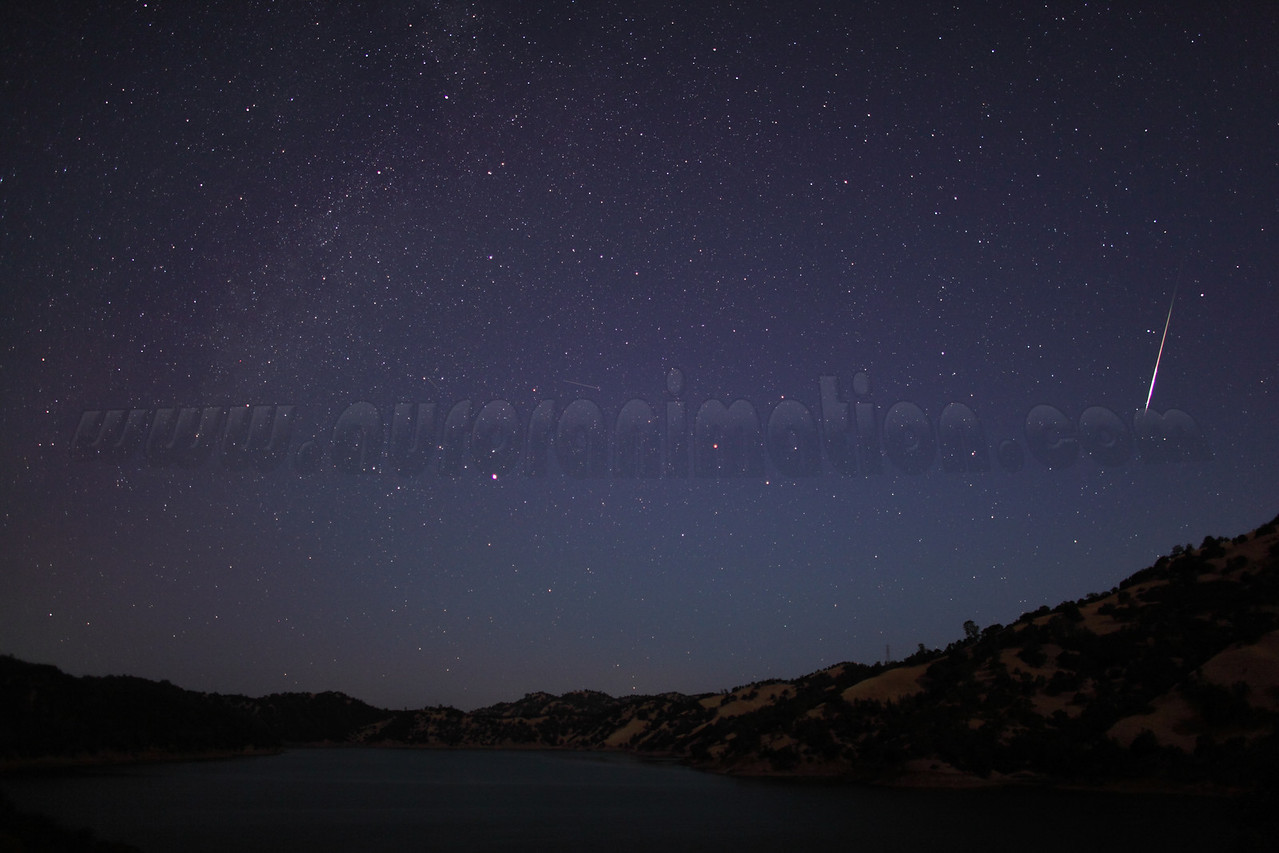 A bright rainbow colored Perseid captured at 5:03 am (PDT) on August 12, 2012 during astronomicial twilight. The scenery is illuminated by a waning crescent Moon.  <br /> <br /> Location: Lake Berryessa, Northern California<br /> Camera: Canon EOS 5D Mark II - Lens: Canon EF 24mm f/1.4 L