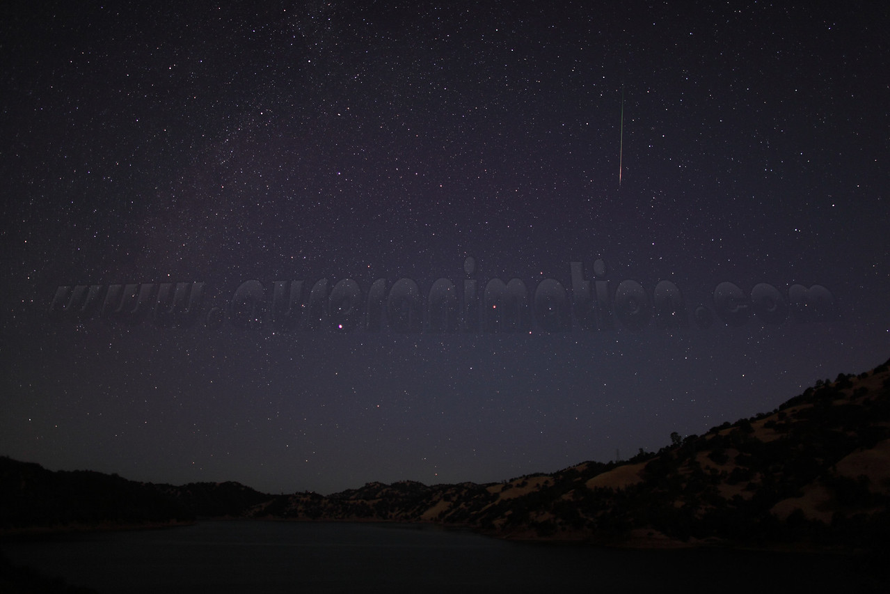A rainbow colored meteor captured at 5:00 am (PDT) on August 12, 2012 during astronomicial twilight. The scenery is illuminated by a waning crescent Moon.  <br /> <br /> Location: Lake Berryessa, Northern California<br /> Camera: Canon EOS 5D Mark II - Lens: Canon EF 24mm f/1.4 L