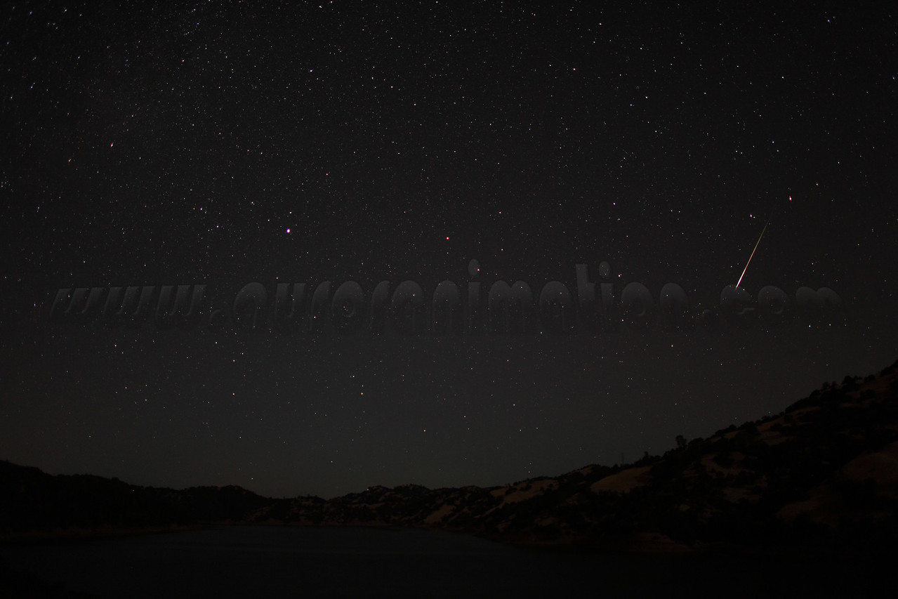 A bright rainbow colored meteor captured at 4:08 am (PDT) on August 12, 2012. The scenery is illuminated by a waning crescent Moon.  <br /> <br /> Location: Lake Berryessa, Northern California<br /> Camera: Canon EOS 5D Mark II - Lens: Canon EF 24mm f/1.4 L