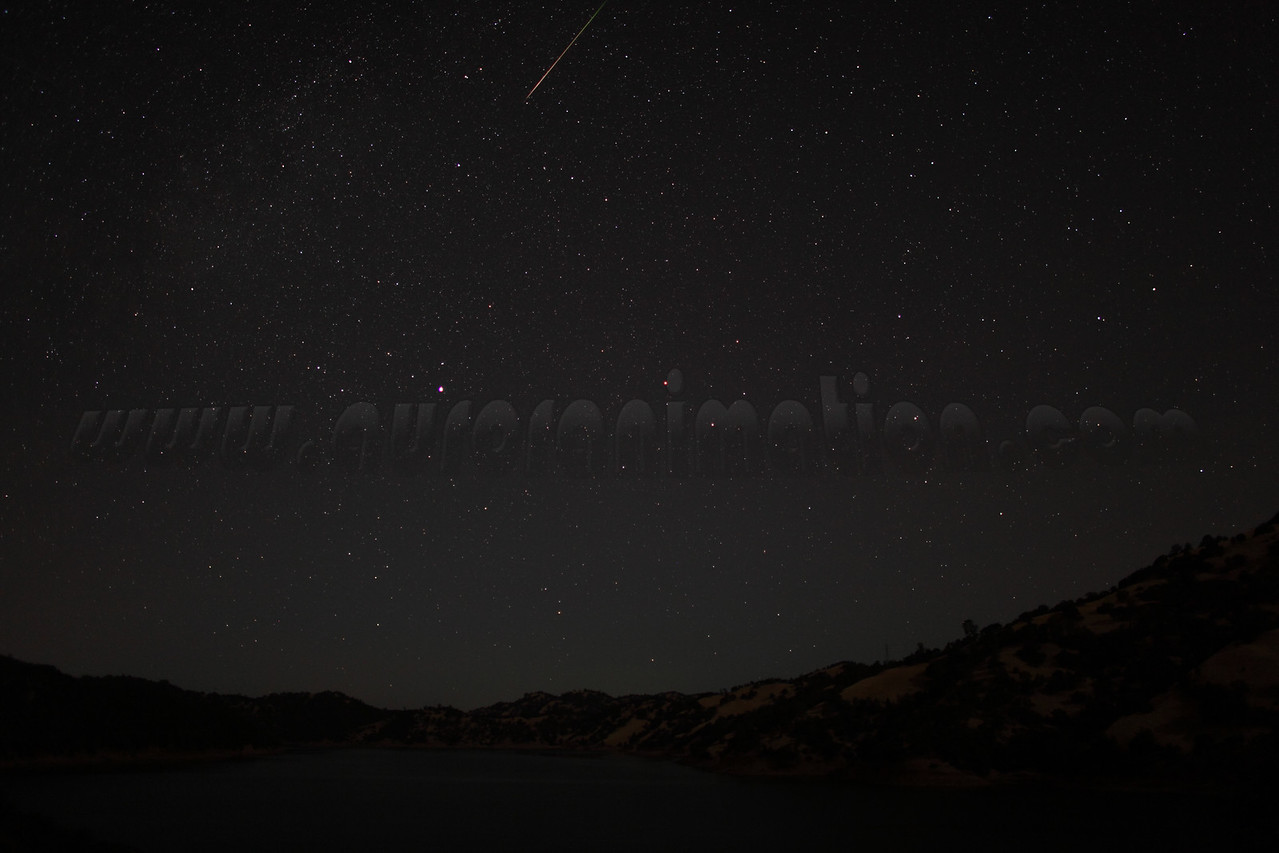 A rainbow colored Perseid captured at 4:30 am (PDT) on August 12, 2012. The scenery is lightly illuminated by a waning crescent Moon.  <br /> <br /> Location: Lake Berryessa, Northern California<br /> Camera: Canon EOS 5D Mark II - Lens: Canon EF 24mm f/1.4 L