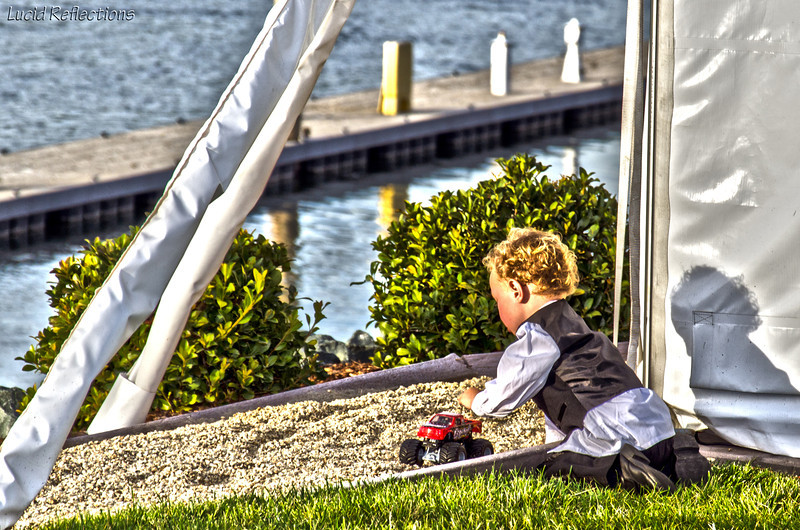 We are all children at heart. HDR composite of the ring bearer at a wedding I attended... taking a play break.