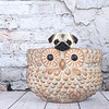 Cute Fawn Pug Puppy in an owl planter.