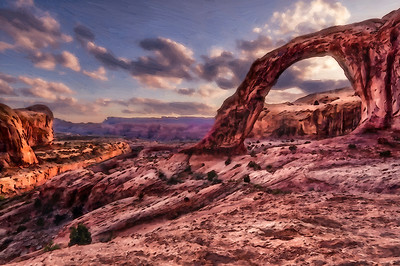Corona Arch in Arches National Park at sunset.