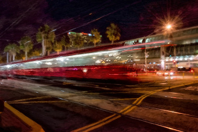 At the crossing in the Gas Light district in San Diego, the trains make their regular crossings.