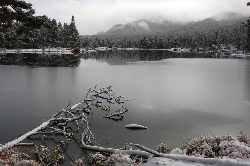 """I was hiking around Sprague Lake in the Rocky Mountain National Park and took this photo looking toward the Bear Lake area.  The lake was just beginning to freeze and everything was absolutely still.  In just a couple of days the lake surface would be completely frozen.  <a href=""""http://rockymountainnationalpark.com/trails/sprague_lake.html"""">http://rockymountainnationalpark.com/trails/sprague_lake.html</a>"""