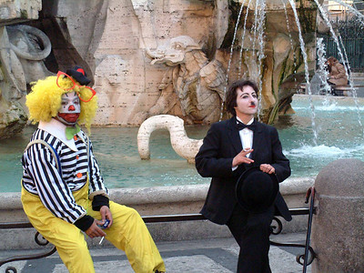 Clown and Mime having a cigarette, Rome, Italy