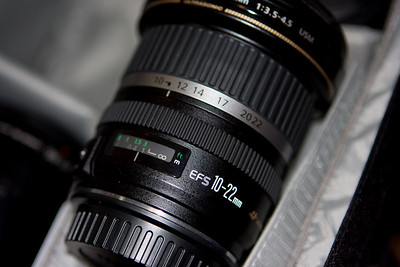The EF-S 10-22mm.  This is a great wide angle lens for crop (1.6) cameras.  10 is very wide, and 22 is quite usable for wide indoor shots, without too much distortion.