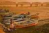 """April 17, 2006 - <a href=""""http://vandana.smugmug.com/gallery/1375324/1/64909276/Large"""">Hype</a> versus reality - Spiritual, sublime  Ganga, the sacred river of the Hindus, cleanser of all sins, is in fact buzzing with boats, bathers & floating corpses. Like all else in India, the devotees seeking solitude coexist with the harsh realities of river commerce. A massive effort to cleanse the Ganges was quickly shuttled after siphoning off the funds to well-heeled politicos."""