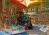 April 10, 2006 - On the streets in New Delhi, India : an old woman selling tobacco