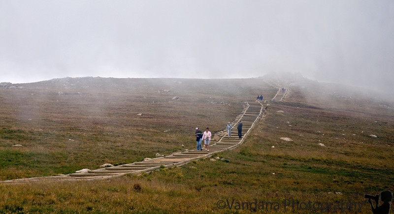 August 18, 2006 - Rocky Mountain National Park @12,000 feet. Reach RMNP to very cloudy,very windy conditions with a dense fog all around. This is at one of the highest visitor centers probably in a NP anywhere.I liked the idea of the steps leading nowhere into the fog.