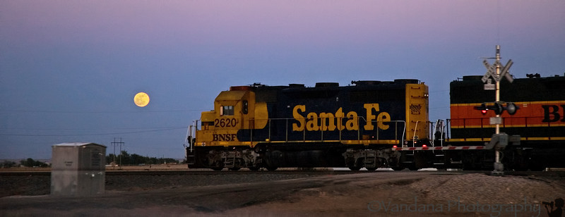 May 12, 2006 - a train passing the full moon.