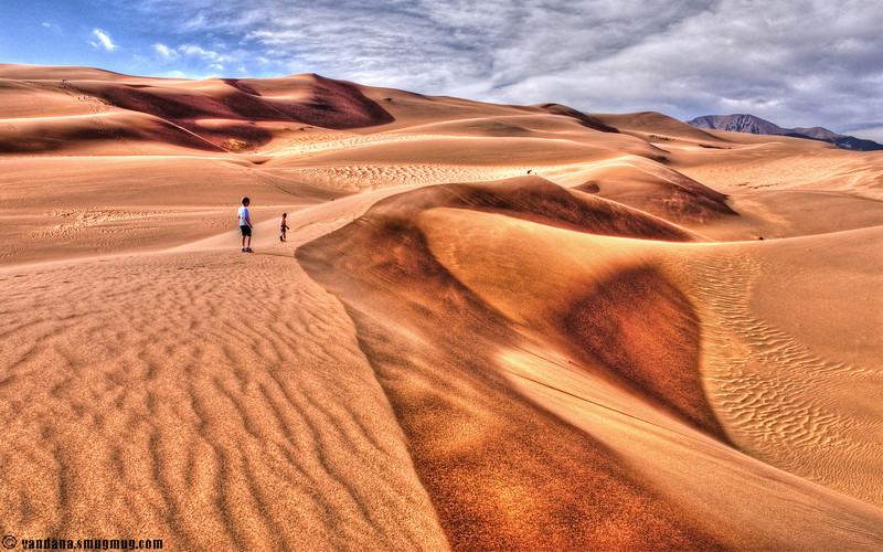 """May 27, 2006 - the Great sand dunes National Park, Colorado. A hike across the dunes, very windy with sand all over. I didn't dare change my lens! but anyways, it was a wide-angle paradise.More pics from Colorado to be added <a href=""""http://vandana.smugmug.com/gallery/1507406"""">here</a>"""