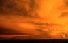 November 29, 2006 - The sky burnt up..and all that was left on the ground very very far away, was a tiny windmill