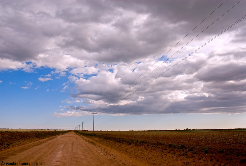 April 17, 2007 - Lens cap blues<br /> <br /> Does anybody see my lens cap on this road ?<br /> Lost somewhere here on the dirt road..maybe these roads don't like to be photographed so often !