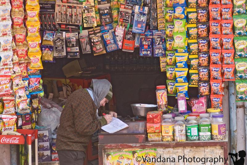 Jan 24, 2008 - a Delhi shopkeeper at work.