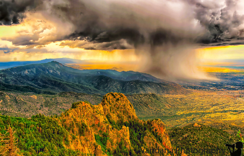 """June 23, 2009 - Thunderstorm at Sandia peak: We reached the 10,378 feet tall <a href=""""http://www.sandiapeak.com/"""">Sandia Peak</a> around  10 am atop the <a href=""""http://vandana.smugmug.com/gallery/3150146_7pe4F#572793010_PB8N2"""">world's longest aerial tramway.</a> Our brief hike atop the mountain was quickly interrupted by thunderclouds and a pouring rain. We took shelter in the observation deck and were informed that the tram to the base would be indefinitely delayed until the thunderstorm cleared away. There were some spells of lightning as well. The observation tower was jampacked with over 150 travellers scheduled to descend the peak once the storm cleared. Finally around 2pm, the storm packed up and we secured a seat in the first tram down to the base. It was quite an adventure, and New Mexico never disappoints!"""