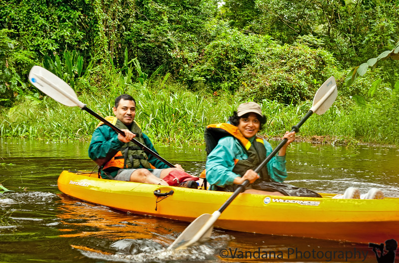 December 15, 2010 - V and K go kayaking in Tortuguero National Park.<br /> <br /> The highlight of the trip was a 4 hour kayak through TNP. We kayaked through narrow canals surrounded by a lush canopy of green forest, and occasionally we would dodge low hanging branches. Sometimes the surrounding overgrowth was so thick it felt like kayaking through a cave. The current was strong and against us on the forward portion, so we ended up bumping into the trees & bushes a bunch of times. Mauricio, our guide on the other kayak, took this picture.<br /> <br /> We spotted turtles, caimans, kingfishers, spider monkeys, and a mating heron pair ! I think we were a good kayak team and got into the rowing rhythm pretty soon. After the trip, we were so hungry we polished our dinner plate clean. Our last day in TNP. Tomorrow Arenal.