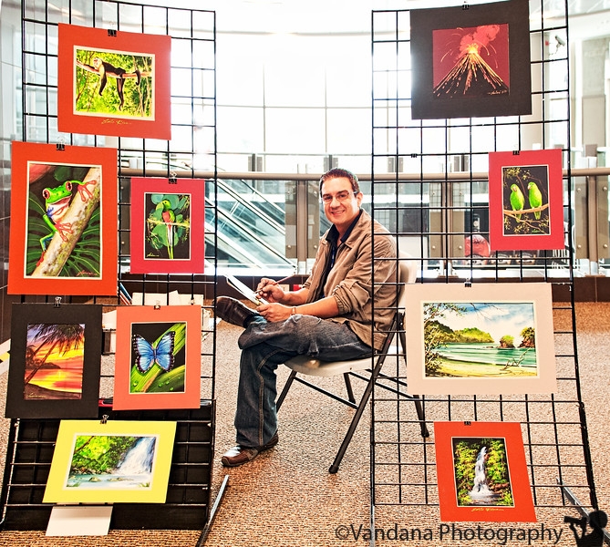 December 25, 2010 - Javier Portuguez, local artist at San Jose International airport, surrounded by his paintings