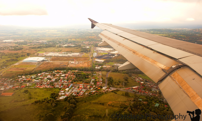 December 12, 2010 - Arrive in San Jose, Costa Rica !<br /> <br /> Woke up at 2 AM to catch the 3AM Van Galder Bus from Rockford to Chicago. Took a cab to the bus terminal in a developing snowstorm, only to be told all buses cancelled! Called the cab back & cut a deal - drive 90 miles to Chicago in the taxicab for $150 in the snowstorm!<br /> The taxi got us in to Chicago at 5:30AM, & we were well in time fort the flight to Charlotte.<br /> The de-icing procedure kept us on the ground an hour longer, so we reached Charlotte quite late...fortunately the flight to Costa Rica was held up just for the two of us! We ran to the aircraft & boarded, & they took off immediately!. 4 hours later, arrived in San Jose international airtport, 80 F !!<br /> Picked up by Costa Rica Expedition & dropped off in Holiday Inn downtown in a minivan.<br /> Walked downtown & participated in the street festivities...thousands of Ticos in a mass Christmas celebration...snagged a falafel pita after a lot of hassle. Couldn't buy a sunscreen at the stores since nobody knows English & we don't know Spanish! V had a frutas sundae at Pops, served by ladies in nurse-like outfits. Big day tomorrow...drive to tortuguero national park.