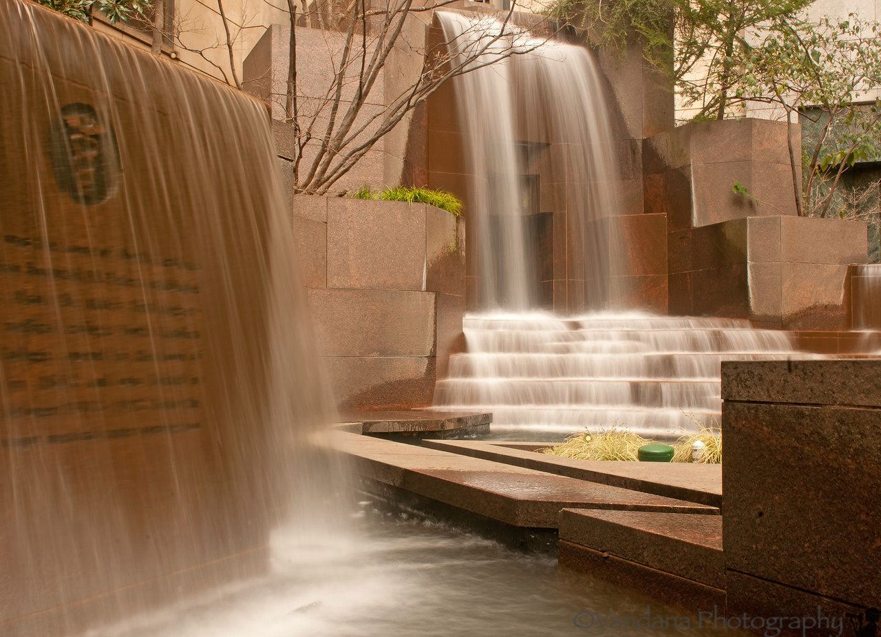 March 27, 2012 - Thomas Polk Park Waterfall fountain, uptown Charlotte<br /> <br /> didnot carry a tripod, so photo taken by keeping the camera on a ledge..leading to a somewhat wierd composition as the area has many water channels and I didn't want to fall into the water !!<br /> <br /> edit: I used a circular polariser here, didn't have a ND filter as a urban waterfall in the middle of downtown Charlotte was kinda unexpected !!