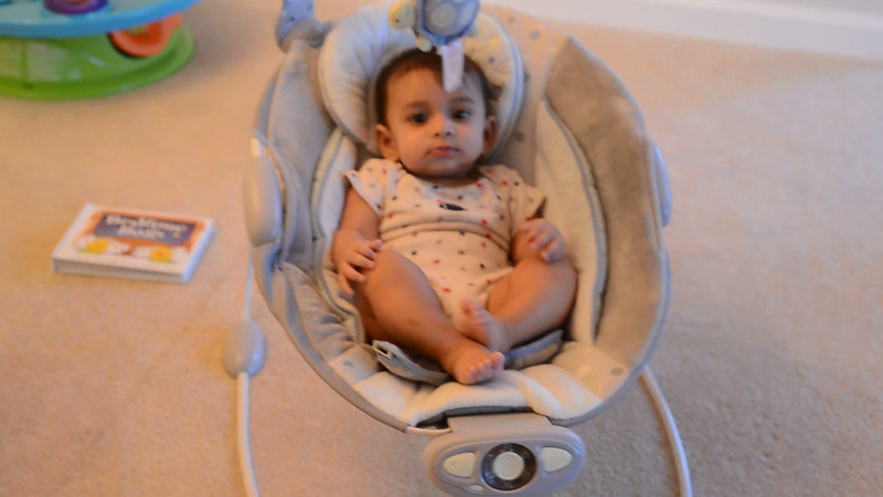 October 14, 2012 - Arjun plays in his bouncer