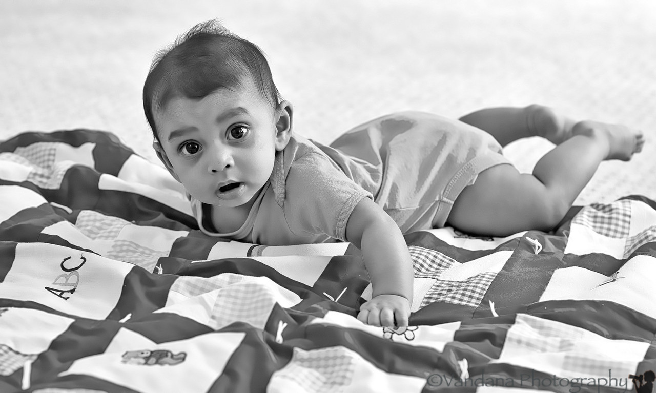 August 26, 2012 - Tummy time for Arjun ! always so busy rolling over !