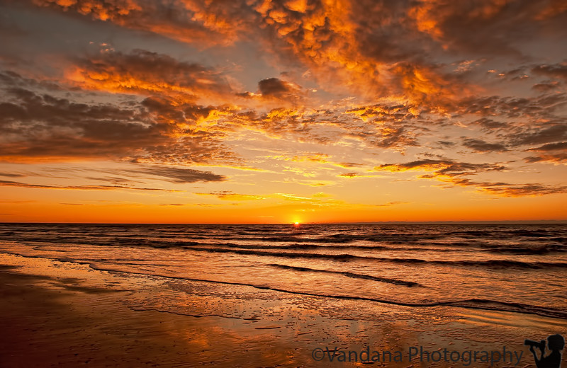 January 17, 2012 - Sunrise at Folly beach, SC<br /> <br /> we woke up early, and walked out to Folly beach from our ocean front hotel to view the sunrise.It was a glorious sight as the colors changed to red, and the sun came out. quite unforgettable a sight !