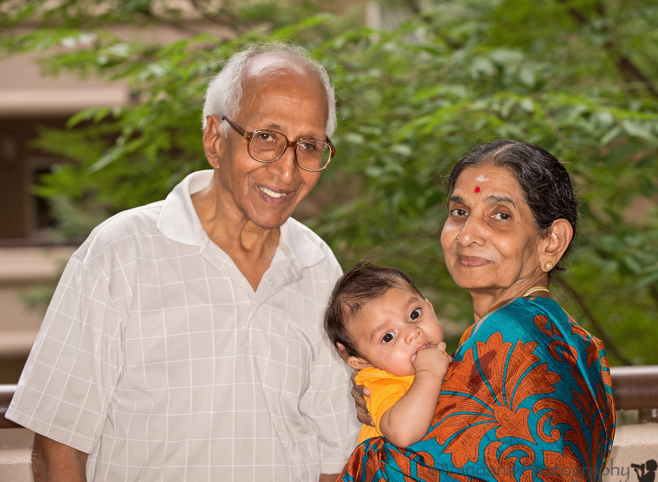 July 14, 2012 - Arjun with his grandparents. <br /> His grandparents leave for India this Sunday :(. Arjun indulging in his pet past-time these days - of chewing his fist/fingers !