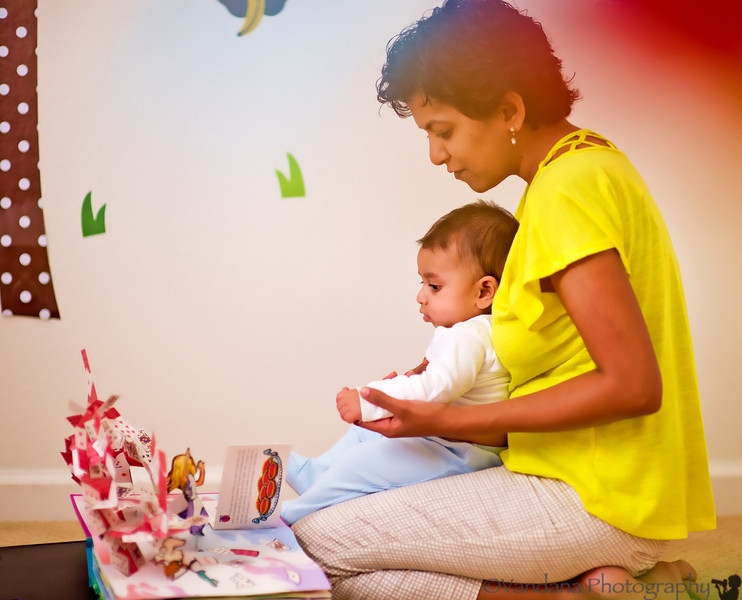 "August 27, 2012 - Reading ' Alice in wonderland' pop up book with Arjun. <br /> <br /> Arjun got his 4month vaccines today - 3 injections, 1 oral - crying and fussy most of the day, finally slept after some infant Tylenol :(.. 13lbs, 13 oz and 25"" tall !"