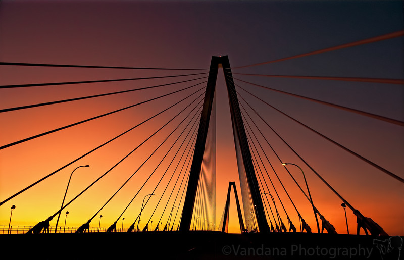 January 15, 2012 - Sunset at  Arthur J. Ravenel Jr. Bridge, Charleston, SC   Arthur J. Ravenel Jr. Bridge is North America's longest cable-stayed bridge. The bridge spanning the Cooper River is 1,546 feet long and connects historic downtown Charleston and Mount Pleasant.   thanks everybody for the wonderful comments on yesterday's photo of K and the birthday wishes. Both of us were quite overwhelmed ! thanks from K as well !  late edit: yes, this is taken from a moving car, K was driving :) !  edit: this shot won the dgrin challenge Angles or shapes in Jan 2012 !!
