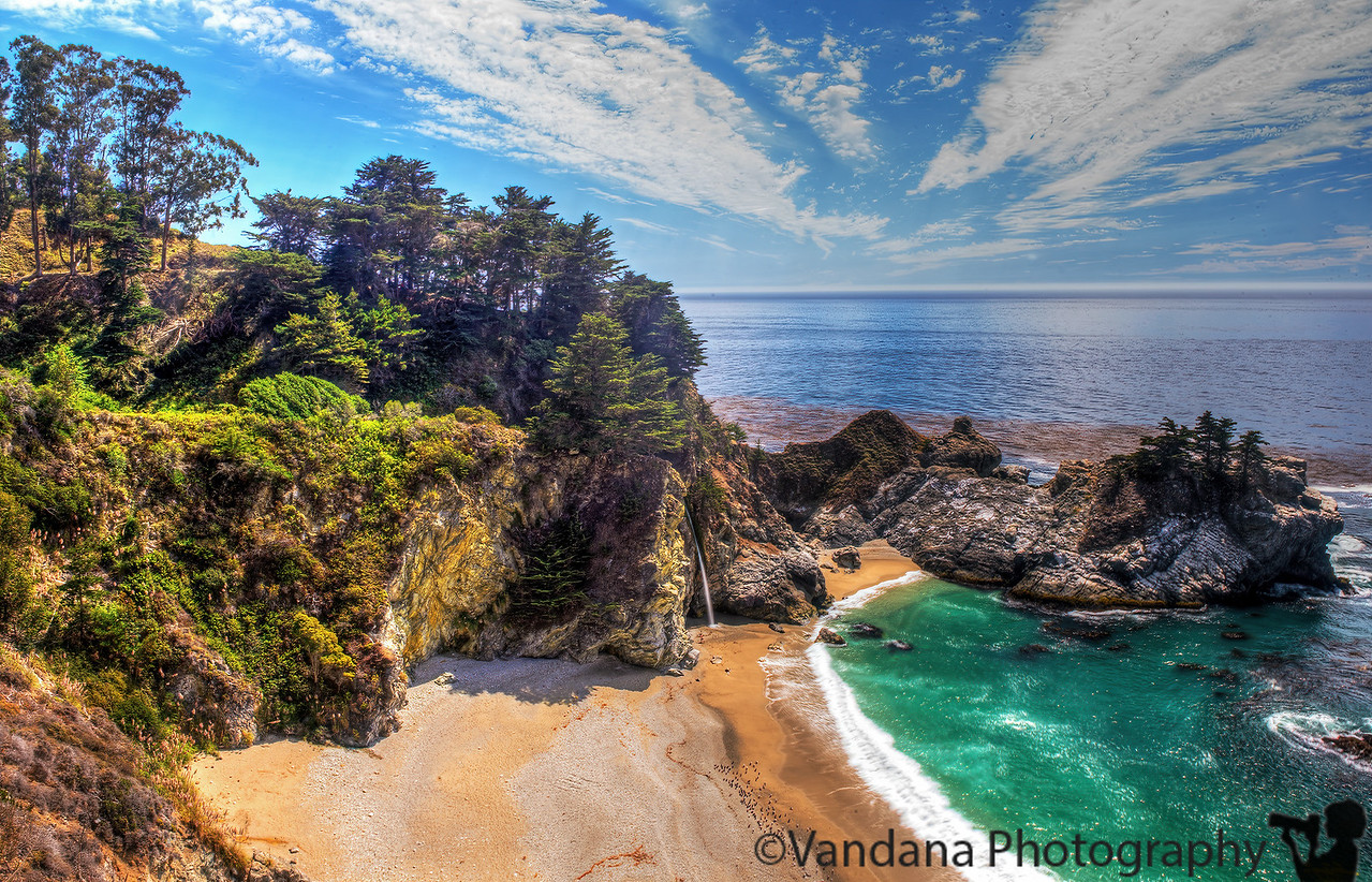 "September 2, 2013 - McWay Falls, Julia Pfeiffer Burns State Park, Big Sur   McWay Falls is an 80-foot waterfall located in Julia Pfeiffer Burns State Park that flows year-round. This waterfall is one of only two in the region that are close enough to the ocean to be referred to as ""tidefalls"", the other being Alamere Falls.  beautiful place, but so so crowded over this long weekend..all the beaches, vista points, state parks were extremely crowded, no parking in most areas..it felt like all of California had landed up here !"